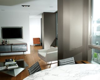 High-Rise Living in Manhattan - Photo 5 of 14 - Architect Cass Calder Smith embarked on a gut renovation to join two apartments inside a SoHo building, resulting in a 1,600-square-foot residence. He redid the floors in oak and redesigned the wall of windows that frames views to the east.
