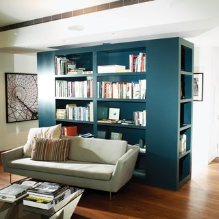 High-Rise Living in Manhattan - Photo 3 of 14 - Calder Smith created the custom bookcase to delineate the seating area and the entrance hallway.