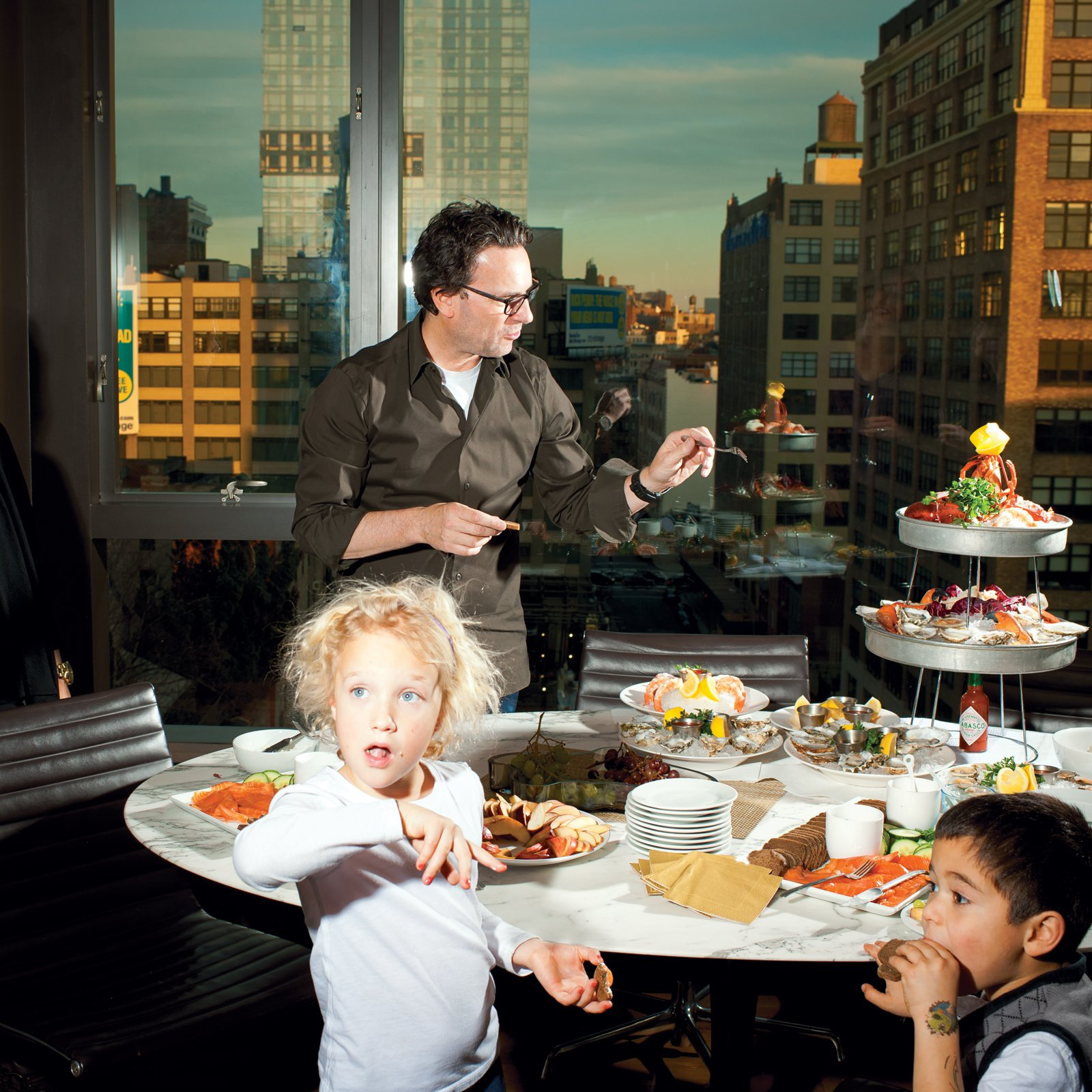 A tulip table is the perfect height for snacking on kid appropriate apple slices and crackers in architect Cass Calder Smith's New York high-rise. Photo by Brian Finke.  Photo 4 of 14 in High-Rise Living in Manhattan