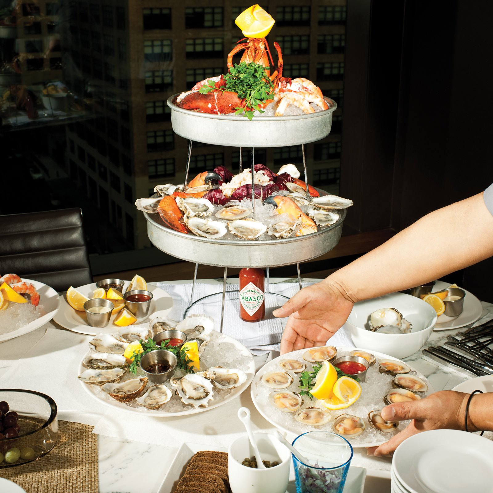 DeLuca's seafood tower delivered straight from his restaurant Giorgione on Spring Street.  Photo 11 of 14 in High-Rise Living in Manhattan