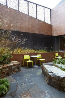 The landscaped courtyard—which features seating, tables, and a bioswale—provides a sheltered place for people to wait for services. Photo by Chris Mueller.