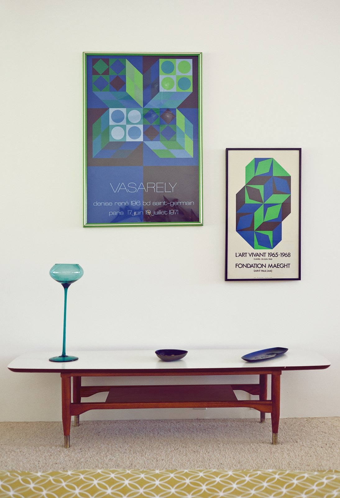 Paton has specialized in pottery and objets throughout her collecting career, though this pair of posters by Victor Vasarely carries this vignette in the bedroom.  Photo 1 of 3 in 3 Tips for Mid-Century Modern Collectors