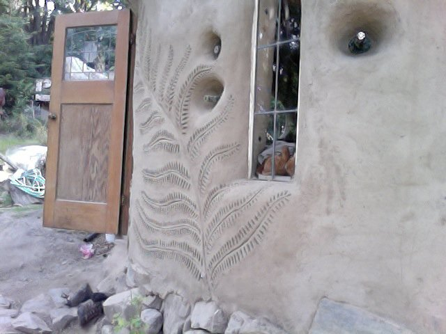 A fern design is emblazoned on a client's home. Photo courtesy of Jen Gobby.  Photo 4 of 5 in Mud Mavens: Mud Girls Founder Jen Gobby