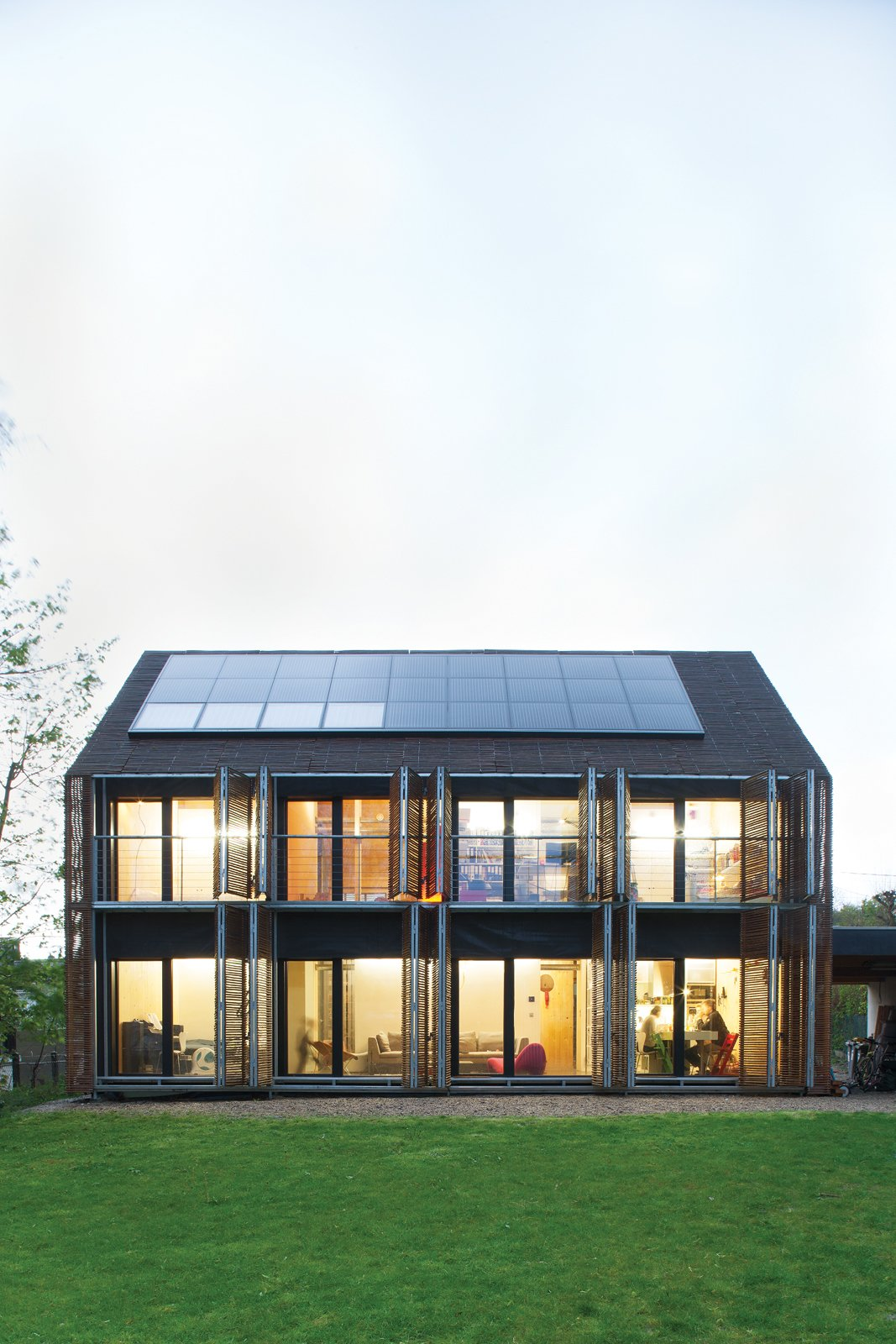 Sun Volt  With the roof angled at 43 degrees, the architects lined the southern slant of the house with solar panels to collect as many rays as possible. Karanesheva and Witzmann started with four, but then added 23 more, all by Systaïc; the company gave them a deal since theirs was its first installation in France. The panels now collect far more energy than the home actually needs, a precious resource that the pair sells back to the power company.  systaic.com  Photo 2 of 8 in Passive Progressive