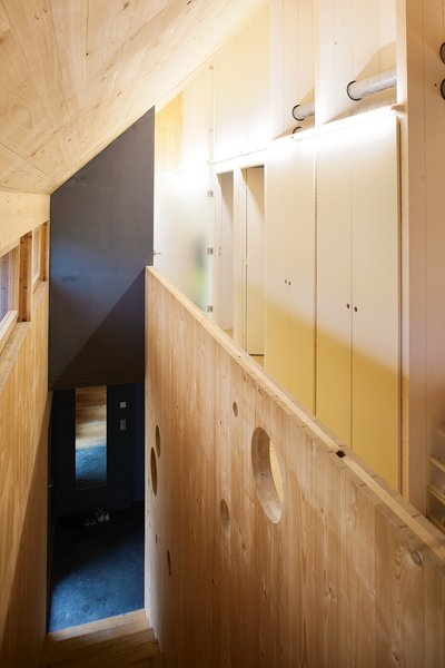 """Dividing Line<br><br>The home's central """"spine,"""" which <br><br>Witzmann describes as """"the back-<br><br>bone of the house at a load-bearing <br><br>and technical level,"""" serves as the <br><br>structure's organizing principle. It <br><br>groups the ventilation system and the <br><br>majority of the electrical networks <br><br>together and centralizes much of the <br><br>home's storage. By siting the living <br><br>spaces on the south of the house <br><br>so that they take advantage of the <br><br>natural light, and placing the sanitary <br><br>and service rooms on the north, the <br><br>architects make the most of a smart <br><br>passive solar layout."""