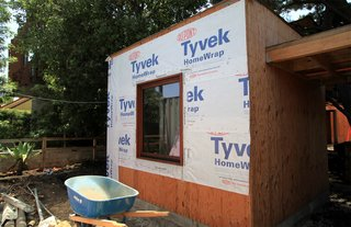 Dwell Home Venice: Part 14 - Photo 5 of 9 - Tyvek wrap and flashing seals the joint between a window and the wall of the front office. Caulking is placed on the interior. Eventually the entire home will be wrapped in Tyvek.