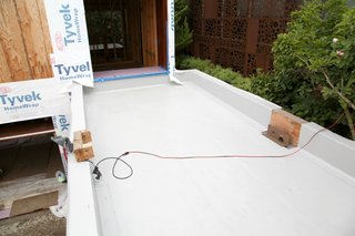 Dwell Home Venice: Part 14 - Photo 9 of 9 - The bridge from a guest bedroom to the media room will be an Intensive green roof. The width between the parapets will be filled with soil for planting. On the right a drainage scupper needs to be installed and then the PVC membrane will seal the area.