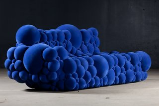 De Ceulaer's Mutation sofa is made of foam spheres coated with a velvet-like rubber powder.