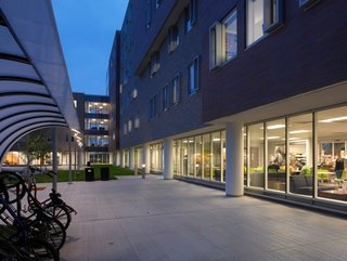 Greiner Hall at University of Buffalo, designed by Cannon Design, boasts floor tiling made from recycled soda bottles, man-made ponds for recycling greywater, electrical outlets that are wheelchair-height accessible, and lounge-style classrooms and meeting areas.