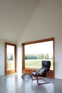 A Sustainably Built Home in Rural Ontario - Photo 12 of 16 - Though the house is only 925 square feet, Moffitt argues that it feels much larger, for which she credits three factors: its visual connections to the outdoors, its open spaces, and its simple interior-design language.