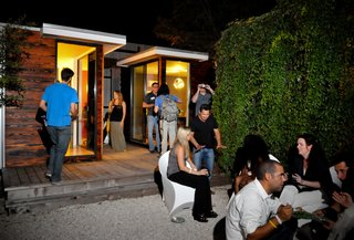 Dwell Party Highlights: Celebrating Prefab Design at SXSW Eco - Photo 7 of 20 - Guests step up to tour two of the prefabs and chat with Sett Studio, Dwell, and GoodLife Team members.