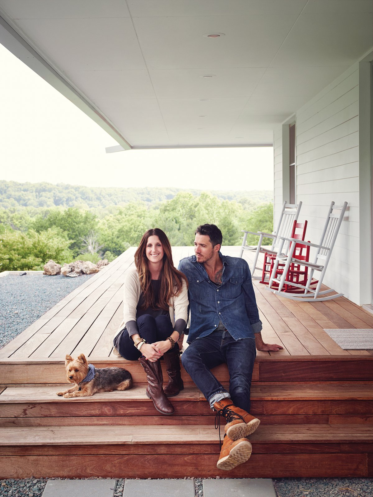 Outdoor, Large Patio, Porch, Deck, and Wood Patio, Porch, Deck Thanks to Matthew Hufft, their envelope-pushing architect and longtime friend, Hannah and Paul Catlett have a new home in southwestern Missouri that's a fresh, unconventional take on the traditional farmhouse.  Photo 4 of 10 in A Modern Farmhouse Recalls Old-Time Americana