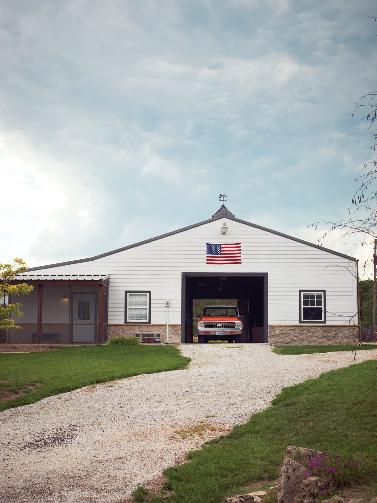 Garage Behind the main house is the barn, where Paul builds furniture and works on cars  Photo 5 of 10 in A Modern Farmhouse Recalls Old-Time Americana