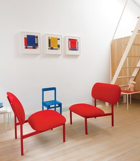 The red chairs were made from castoffs as part of Tolstrup's Re-Imagine series, and the blue one is a small Pallet chair from Studiomama.