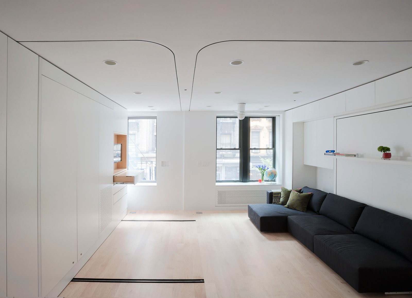 The open layout, maple floors, and white cabinetry make for a bright, airy feel in the 420-square-foot space.  Photo 1 of 12 in Small Space Living by LifeEdited