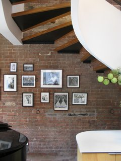 Exposed brick on the north facing wall with plenty of light, even on a rainy day.