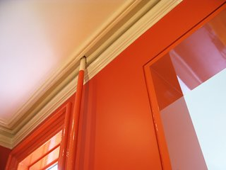 """A subtle, yet striking detail is the combination of matte and high-gloss paint. """"Our painter, who is awesome, asked: What do you want to do with the molding?"""" the owner explains. """"Just for fun we used this high gloss oil paint and we said, 'Let's do that. That sets it off the most.'"""""""