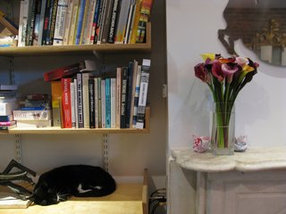 The marble mantelpiece was one of the only salvageable elements in the home. The family cat—who made this shelf her home—was a favorite surprise of visitors on the tour.