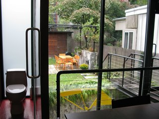 View of the garden and bath from the dining room.