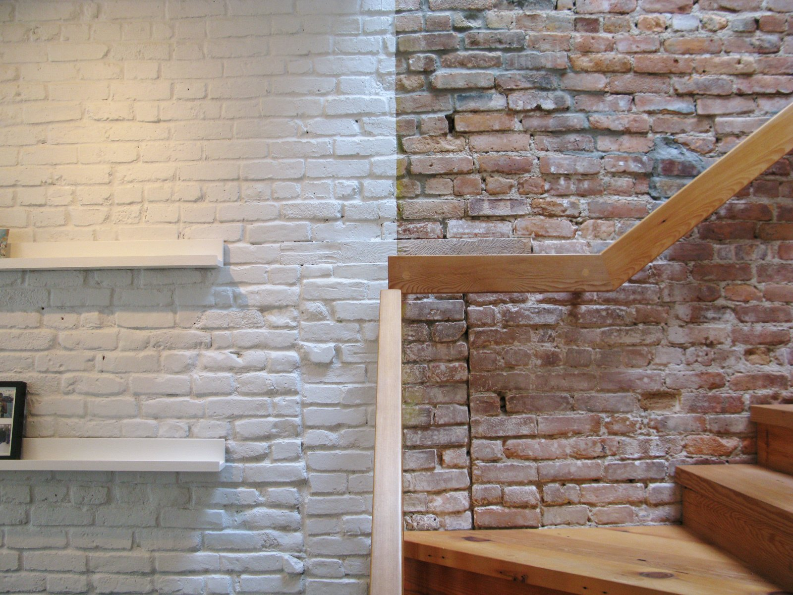 Exposed and painted brick walls in the living room.  Photo 10 of 10 in Revealing the Pros and Cons of Exposed Brick and How to Take Care of It from City Modern Home Tours: Brooklyn