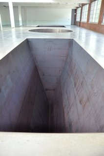 North, East, South, West, Michael Heizer, 1967/2002. Dia Art Foundation.<br><br>In addition to rotating exhibits, Dia also has several works on permanent view. This includes the above piece by Michael Helzer, which gives visitors the feeling of an endless drop when viewed from the right angle. Though roped off for safety reasons, those lucky enough to be allowed past can experience a jarring optical illusion that displaces the senses, while also creating a sense of aesthetic wonder.