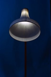 BIO 23 Honorable Mention Award winner, Amsterdam-based designer Rick Tegelaar's MeshMatic lamps demonstrate the poetic fusion of simple materials like chicken wire mesh and luminous bamboo paper. Wet bamboo fiber is formed over the mesh on wooden molds and allowed to dry – allowing for very controlled and accurate shaping.