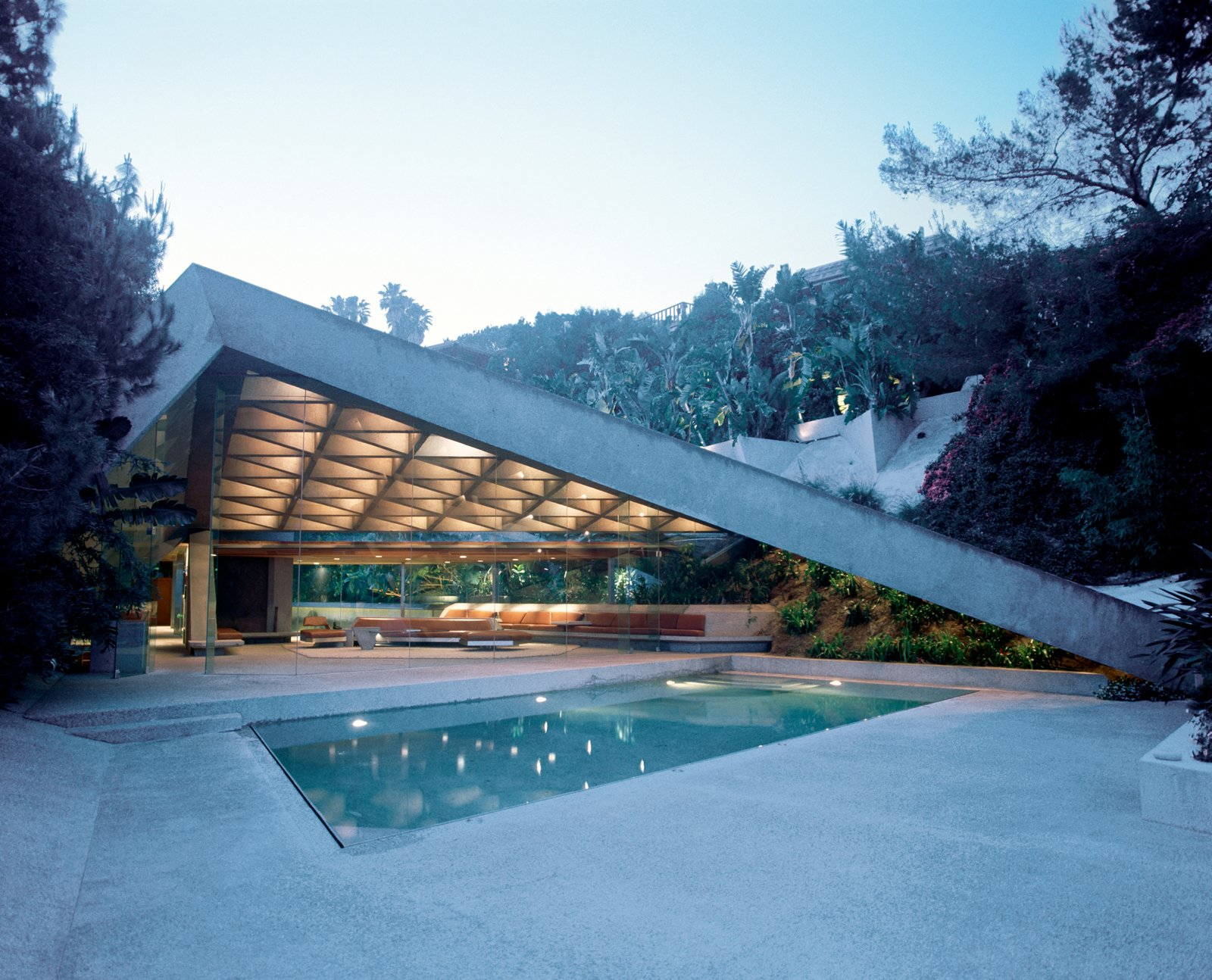 This is John Lautner's Sheats House from 1963.  Photo 1 of 1 in Discuss: What's Your Favorite Work of Architecture in Film? from Phaidon's 20th Century World Architecture Atlas