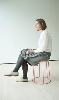 The 29-year-old designer, Catherine Aitken, on one of her stools for Fade.