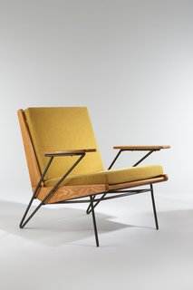 Armchair, 1953. Ash, black enameled metal, upholstered. By Pierre Guariche.