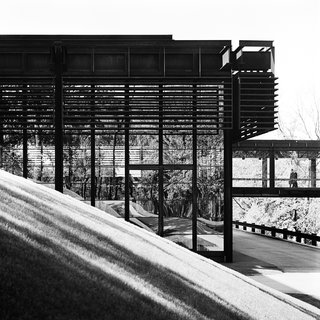 """Balthazar Korab, quoted in a new book by John Comazzi, found that Eero Saarinen and Associates' Deere and Company Headquarters from 1966 """"was the most challenging of Saarinen's buildings to photograph because the darkness and texture of the Cor-Ten steel creates difficult light and shadow conditions. For me it was a project of discovery—I had to discover the architecture over time."""""""