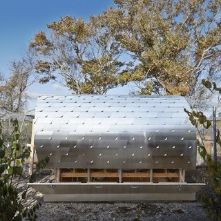 Architecture Reseach Office's 60-square-foot chicken coop streamlined a Hamptons backyard: the concept was to create a series of folded shingles, textured pieces of aluminum that would complement the more rustic aesthetic. Radiant heating, one of the structure's amenties, is a coop must-have, according to the architect.