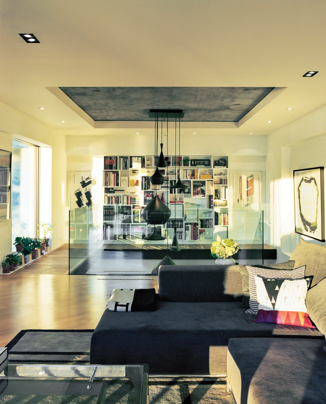 """""""We wanted a space for entertaining groups, and also ourselves, that felt open—almost like a loft,"""" says Peart of the couple's mezzanine-level living room.  Photo 2 of 9 in A Renovated Flat in Moshe Safdie's Habitat '67"""