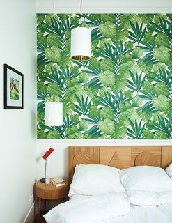 The headboard in Hansen's bedroom echoes the 2013 sideboard. The wallpaper is from Arte.