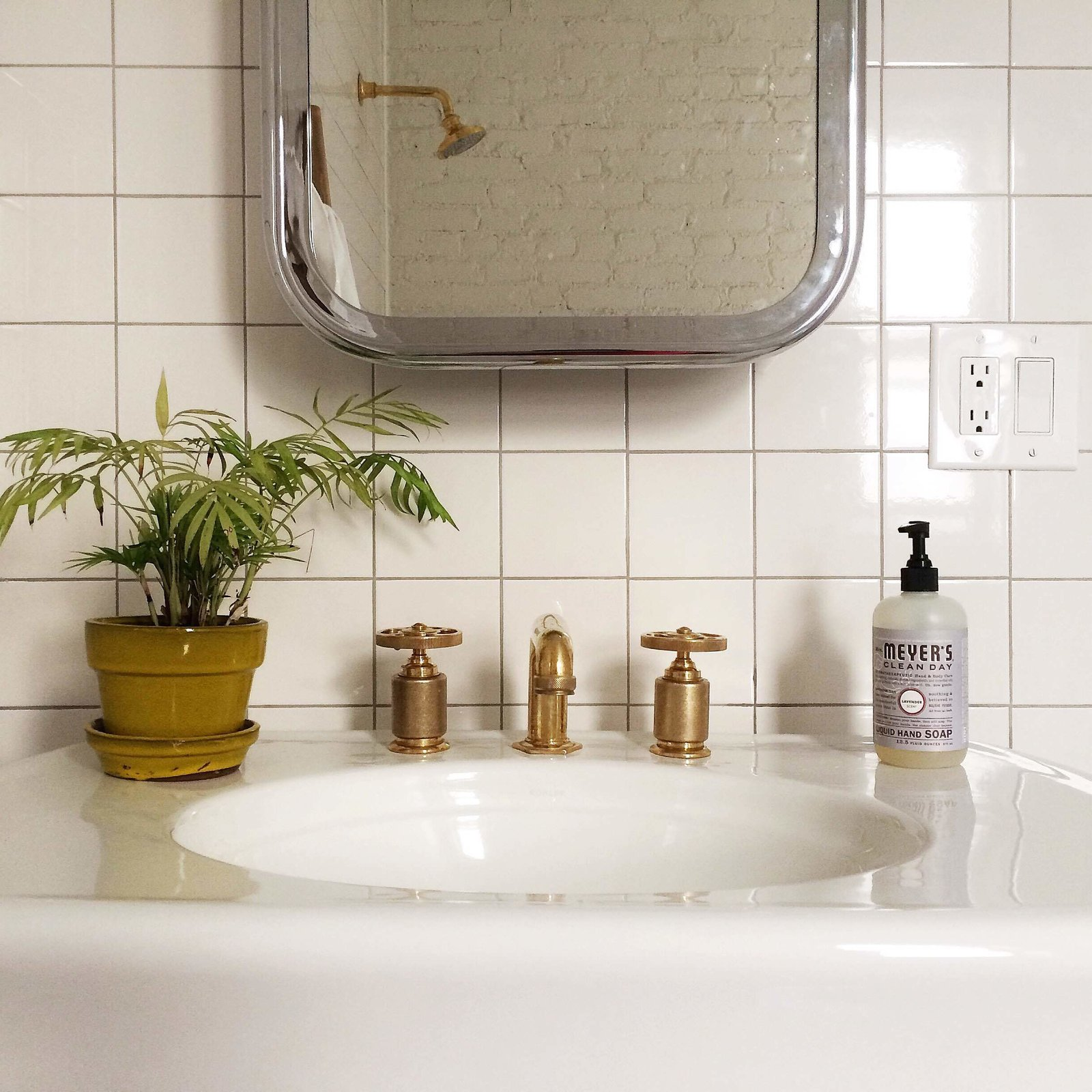 Photo of the Week: Brass Bathroom Hardware by Roman & Williams