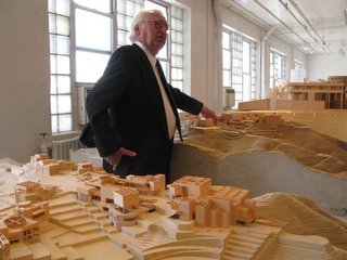 """Richard Meier on a tour of his firm's model museum in Long Island City, 2010. (Photo: Kelsey Keith)<br><br>Addressing the common practice of architectural competitions, Meier explains, """"Sometimes if you do a competition, you know you're taking a risk of it not happening. Many of them that we've done remain unbuilt for us, and unbuilt for anyone. We always look at competitions very carefully to try and determine whether it's just emotion on the part of the sponsors or it's something real."""