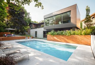 Thellend Fortin Architectes designed this two-story addition in the OUtremont neighborhood of Monteal to capture views from the steeply sloping lot.