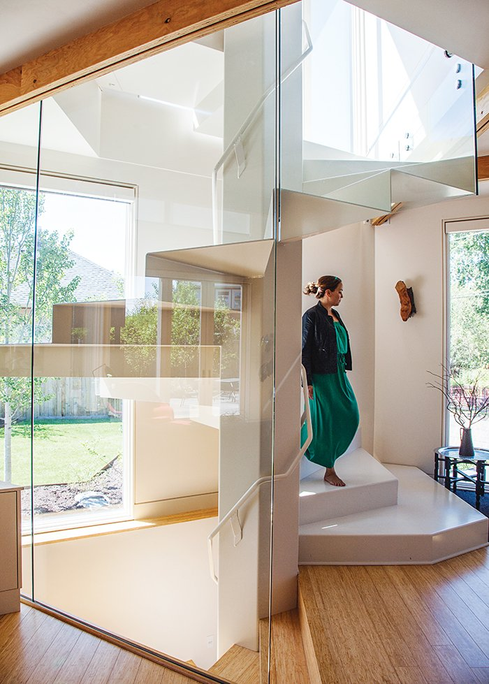 Staircase and Metal Railing The core of the glass-enclosed spiral stair is a hexagon, a reference to the moments in the floor plan in which six triangular modules are joined together to form the shape.  Photo 7 of 12 in 28 Triangles Make Up This Hyper-Angular Family Home