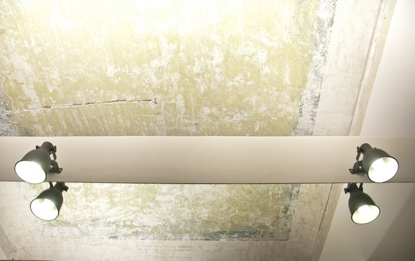 A fading ceiling was preserved in the bedroom. Clear resin was applied to the blue and green pigments to freeze and preserve the aging wall.  Photo 8 of 9 in Industrial Pied-à-Terre in Italy