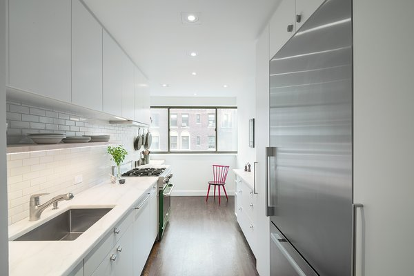 The owners of this storage-savvy apartment in New York, who are avid cooks, worked with a design duo and a contractor found on the site. To make the kitchen seem larger than it is, the team decided to place the largest cabinets and appliances near the entryway, with less clutter toward the window.