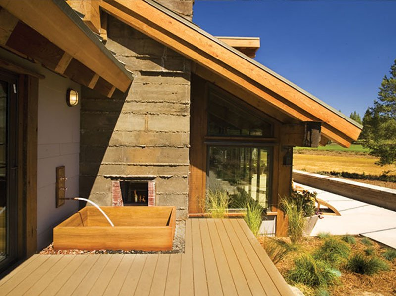 Close to Lake Tahoe, Roberts Hot Tubs built this teak tub to take advantage of stunning views, positioning it next to a two-sided fireplace. The drain is hidden under river rocks. Teak is a good choice for an outdoor tub as it withstands the elements.  Roberts Hot Tubs prices ofuros from $5895, says Andrew Harris, and they take 60-90 days to build – they can even include jets. Other manufacturers have similar prices and lead times for a made-to-measure tub. Photo courtesy of: Roberts Hot Tubs  Photo 8 of 13 in Japanese Soaking Tubs