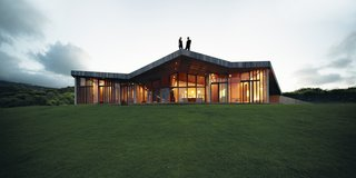 """We sought to create a house that would not damage the environment and not be too visible,"" says architect Tina Gregorič. A single zigzagging roof stretches over 5,380 square feet, doubling the area of the interior spaces and serving as an ideal spot for sunset cocktails and whale-watching in Maui."