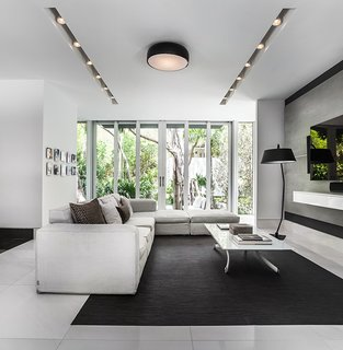 This Modern Miami House Feels Like It's in the Middle of the Jungle - Photo 6 of 12 - The interiors feature neutral, muted tones in order to highlight the views of the property.