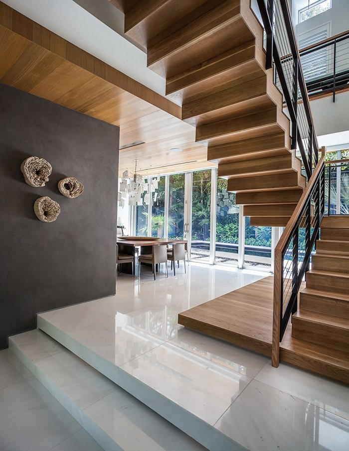 The ground level contains the living and dining spaces. Upstairs there are two bedrooms, plus the master suite.  Photo 7 of 12 in This Modern Miami House Feels Like It's in the Middle of the Jungle