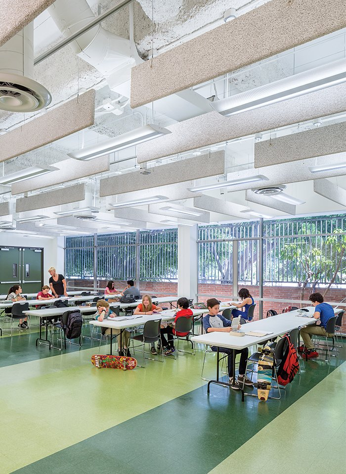 Contemporary on the inside and modernist on the outside, this school stands as a model of successful and sensitive adaptive reuse.  Photo 1 of 5 in A Forgotten Insurance Building Finds New Life as a Humming High School