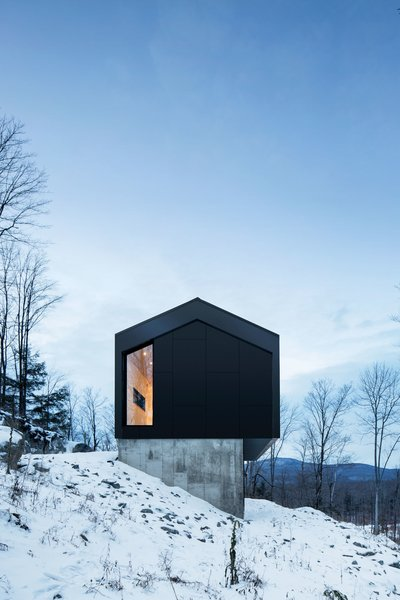 Exterior, House Building Type, Metal Siding Material, Metal Roof Material, and Cabin Building Type Architects Stéphane Rasselet and David Dworkind delivered with a strikingly simple concept, anchoring two stacked, rectangular volumes into a steep mountainside surrounded by awe-inspiring vistas.   Photo 11 of 21 in 20 Modern Winter Cabins We'd Love to Hole Up In