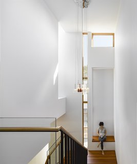 While the house is spread over two stories, Tedesco alotted space for an elevator, should the residents have mobility issues down the line. The pendants are Spillray by Axo and the windows are Loewen.