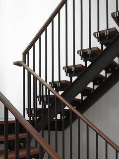 Smart Tech Makes this Modern Home Ultra Energy Efficient - Photo 6 of 11 - Tedesco's father was a precision machinist and his uncles worked as welders and carpentry framers. As a tribute to his family's history, Tedesco made the blackened-steel-and-wood staircase a focal point—it can be seen from nearly every room in the house.