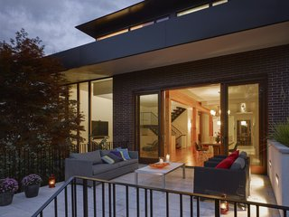 Smart Tech Makes this Modern Home Ultra Energy Efficient - Photo 10 of 11 - A deck is located off the dining area.