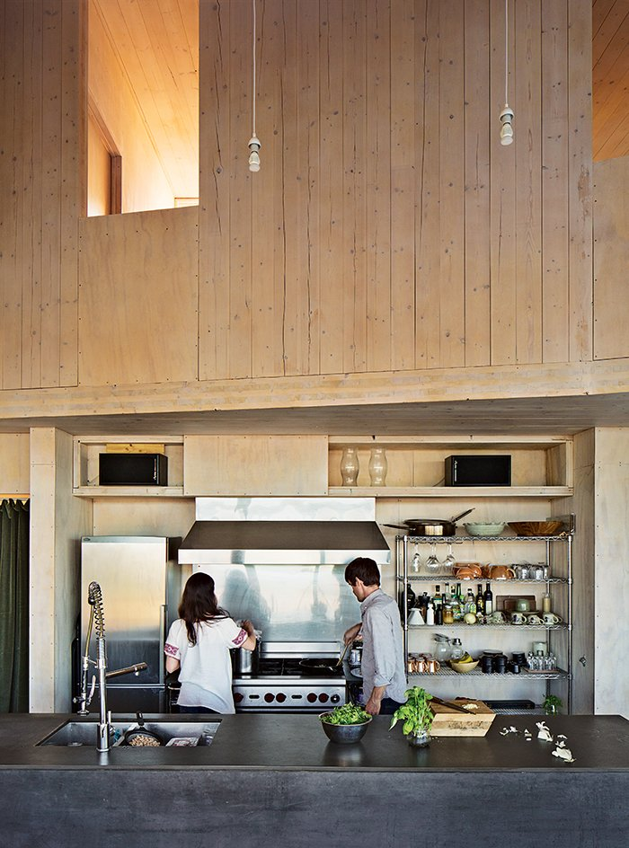 Kitchen, Metal Counter, Pendant Lighting, Range, And Range Hood The Kitchen  Island