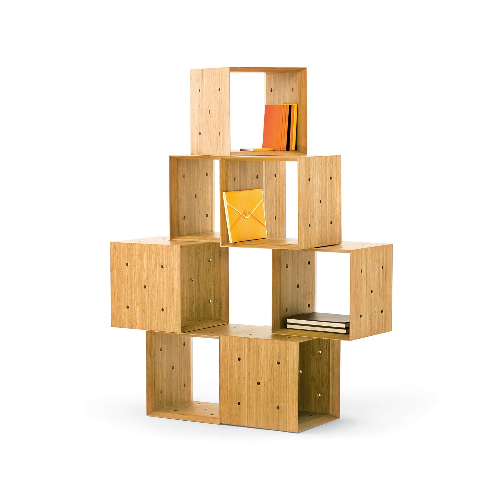 These blocky units lock together with the help of five holes per side––allowing them to take the shape of a miniature library, a bench, or an asymmetrical shelving unit. Read more about this clutter buster here.  Photo 3 of 4 in Tips for Buying Wood Furniture